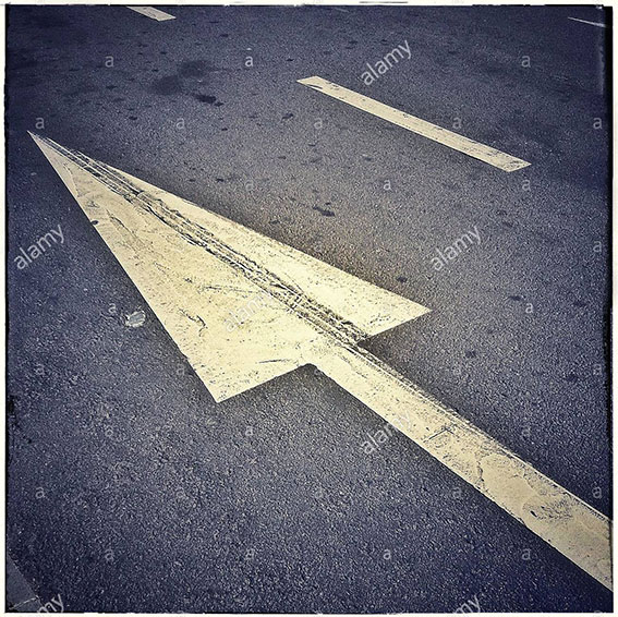 Arrow on asphalt road, one direction traffic sign stock photography