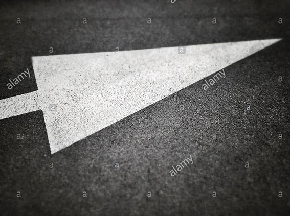 Arrow sign on asphalt stock photography