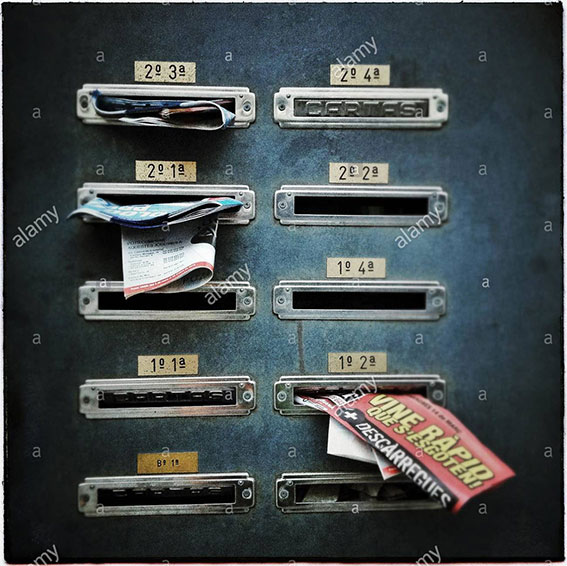 Building letterboxes full of junk mail in Barcelona, Catalonia, Spain stock photography
