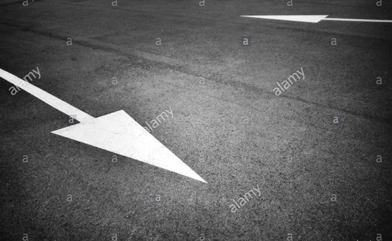 Painted opposite white arrow sign on asphalt stock photography