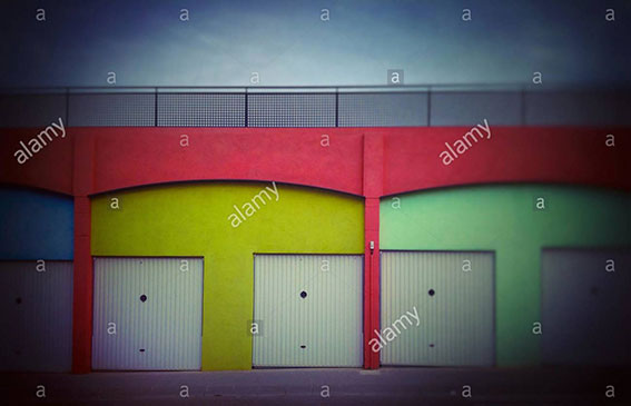 Colourful building with eyes t door. Faces in objects. Palafolls, Catalonia, Spain stock photography