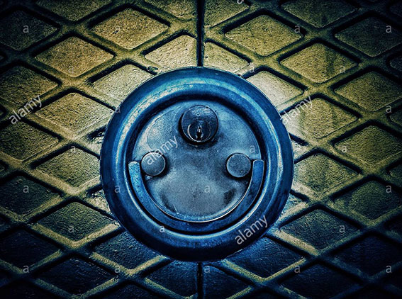 Door lock padlock smiling. Faces in objects stock photography