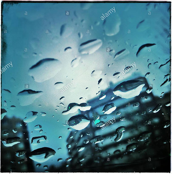 Drops of water on a car glass. Faces in objects stock photography