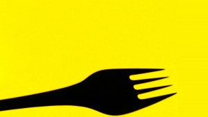 Fork on yellow background stock photography © Queralt Sunyer