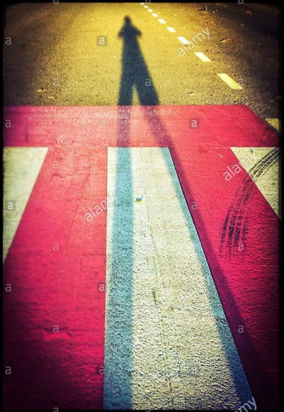 Shadow of an anonymous person on a pedestrian crossing © Queralt Sunyer