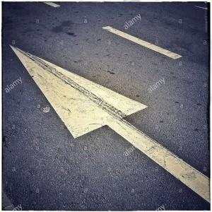 Arrow on asphalt road, one direction traffic sign © Queralt Sunyer