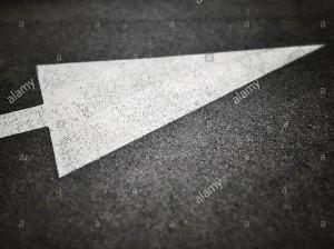 Arrow sign on asphalt © Queralt Sunyer