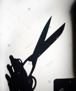 Shadow of a scissors on white background © Queralt Sunyer