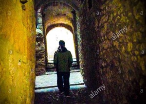 Single silhouette walking through a dark alley in the Call (jewish quarter), Girona, Catalonia © Queralt Sunyer