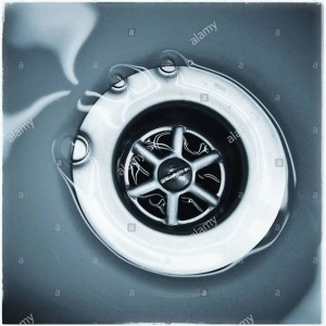 Water running down the plug hole in bathroom sink © Queralt Sunyer